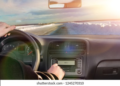 the road in the winter in the car window. a man driving a car. journey.