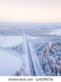 Road in winter wonderland in Finnish Lapland. Winter scenery. Landscape photo captured with drone. Portrait.