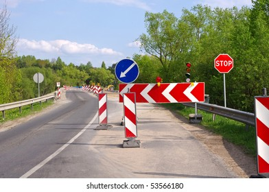 Road work, detour and road construction signs