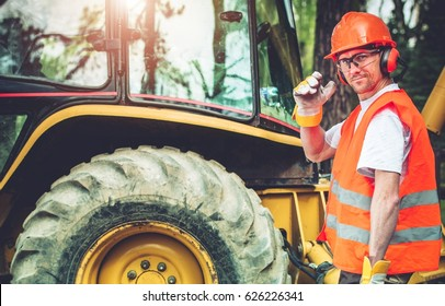 Road Work Job. Caucasian Highway Worker in His 30s Wearing Hard Hat and Safety Glasses. Road Construction