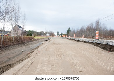 Road work where an old road is being replaced by a safer and wider road.