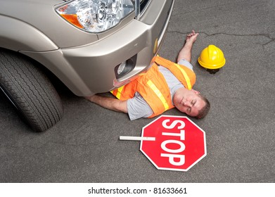 A road worker is hit by a car.