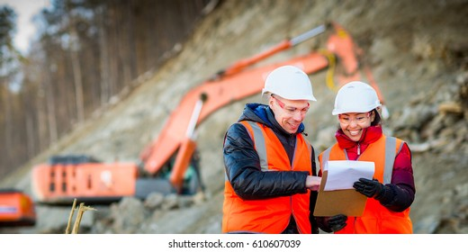 Road workers inspecting construction