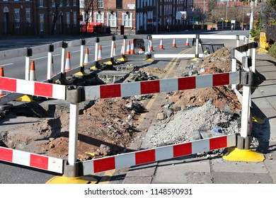 Road works in Liverpool, UK. Street repair sealed off with barriers.