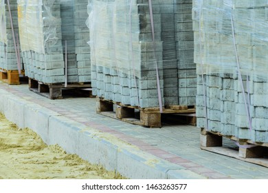 road works on laying paving slabs with laying of sand