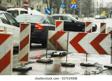 road works on the street with car in background, winter,