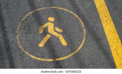 Road yellow paint sing walk zone close up view bike path asphalt park