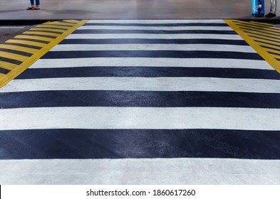 Road zebra crossing with speed bump. Defocused photo with soft focus.