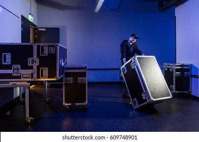 Roadie tipping a flightcase over on it's side