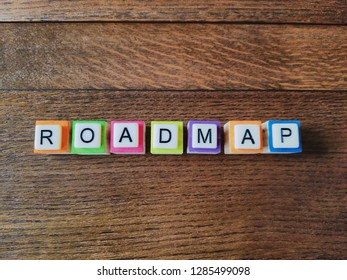 Roadmap text colorful letters on wood background, flat layout
