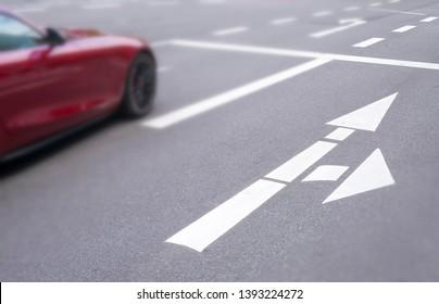 Roadmarking, car on a downtown street