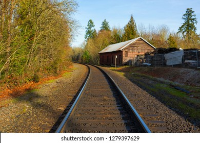 Roadroad train track in historic antique district in Aurora Oregon on a sunny clear blue sky afternoon
