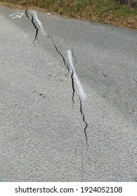 Roads cracked down as a result of landslides. A landslide is defined as the movement of a mass of rock, debris, or earth down a slope. Soil Settlement due to vertical movement of the ground.
