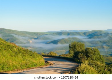 The roads of the East Kazakhstan region are quirky between the low mountains. Early in the morning in the summer in the lowlands you can often see layers of fog