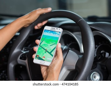 Roads in Thailand -  August 25, 2016: An Android user loads Pokemon Go in a car, a free-to-play augmented reality mobile game developed by Niantic for iOS and Android devices.