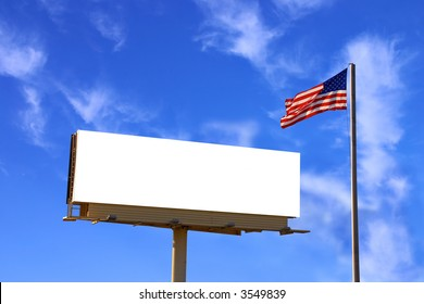A roadside billboard with an American Flag next to it. The sky has been carefully replaced with another similarly lit sky but with more clouds