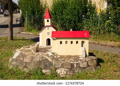 Roadside Church. Miniature model of the church. Small rural wayside shrine. Lower Austria. Burgenland. Central Europe.