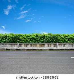 Roadside  and pavement on blue sky