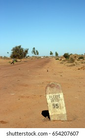 Roadside post marks the way to the river Niger and Timbuktu in Mali on 12 December 2007