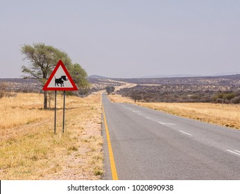 Roadside sign warning of wildlife - in this case, Warthogs