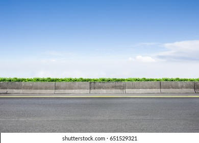 Roadside view and shrubs on blue sky