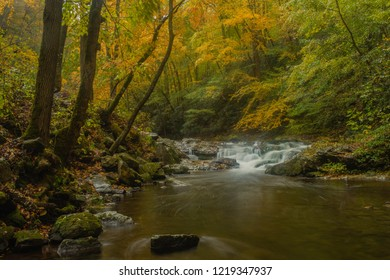 A roadside waterfall in Great Smoky Mountains National Park Tennessee in Autumn
