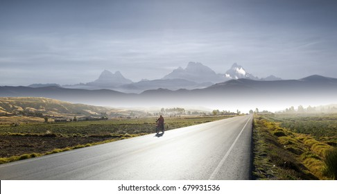A roadway in the Andes of Huancayo Peru, with Huayta pallana mountain as background.