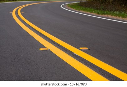 Roadway divider lines and markers