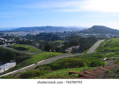 Roadways weave up, over, and through hills at Twin Peaks in San Francisco, CA