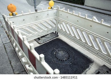 Roadworks road construction topsoil asphalt tar with manhole cover