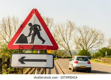 Roadworks sign with directional arrow on UK motorway