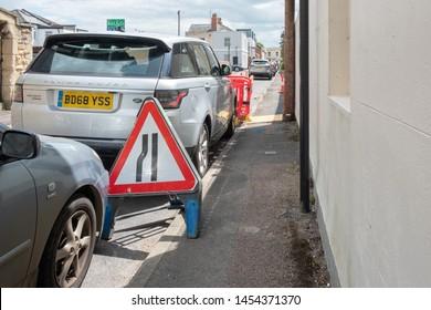 Roadworks with warning signs, Cheltenham, UK. May 2019