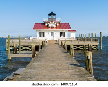 Roanoke Marshes Light, in the harbor at Manteo, North Carolina, is a replica of the  screw-pile  lighthouse that was originally located several miles south near the community of Wanchese.