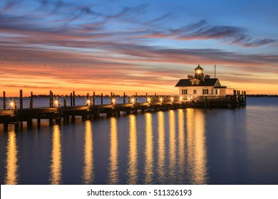 Roanoke Marshes screw-pile lighthouse on Shallowbag Bay in Manteo, North Carolina in the Outer Banks at sunrise.