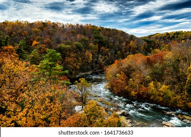 The Roanoke River cloaked in autumn beauty along the Blue Ridge Parkway National Park, Virginia, USA