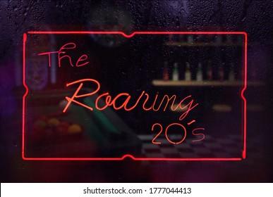 The Roaring 20's Neon Sign in Rainy WIndow