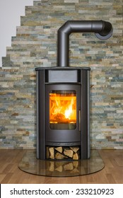 Roaring fire inside wood burning stove in living room