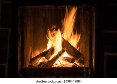 Roaring flames in a modern fireplace