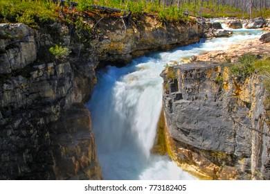 Roaring waterfall from Tokumm Creek at Marble Canyon hike in Kootenay National Park, British Columbia, Canada, near Banff.