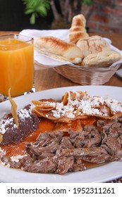 "Roast beef with chilaquiles and refried black beans ""arrachera con chilaquiles"""