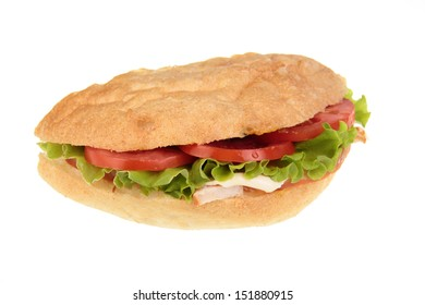 Roast beef sandwich with lettuce, tomatoes, cucumbers and radishes isolated on white
