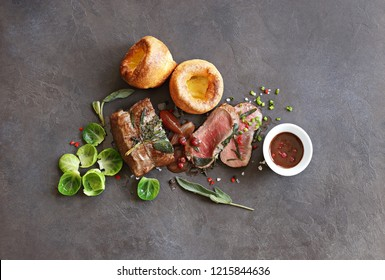 Roast beef with yorkshire pudding, brussels sprouts, porcini mushrooms and shallots. Traditional british roast beef. Overhead view