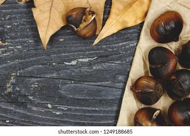 Roast Chestnuts on a dark background
