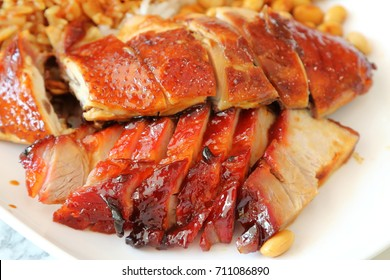 Roast chicken and barbecued pork (Char Siew) in a plate, a famous dish in Singapore and Hong Kong