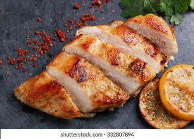 roast chicken breast with lemon and vegetables