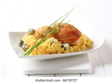 Roast chicken breast served with couscous and blue cheese