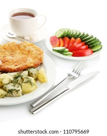 Roast chicken cutlet with boiled potatoes and  vegetables, cup of tea, isolated on white