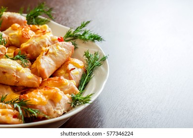 Roast chicken with fennel on a white wooden background