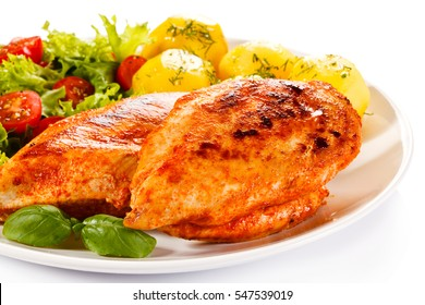 Roast chicken fillets, boiled potatoes and vegetable salad
