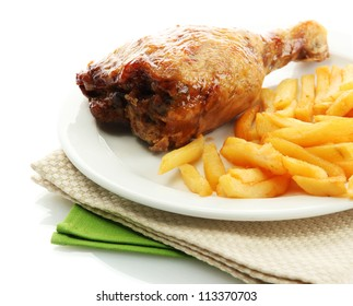 Roast chicken with french fries on plate, isolated on white